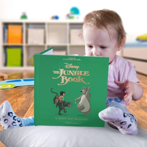 Toddler reading The Jungle Book personalised book