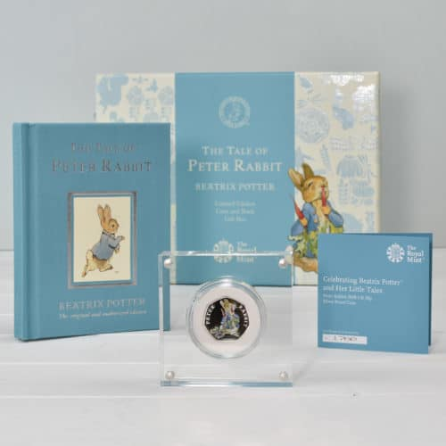 Peter Rabbit box contents with Royal Mint limited edition coin