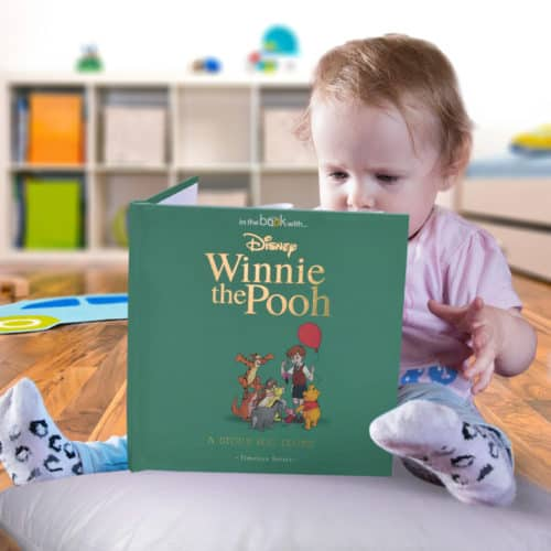 Toddler reading Winnie the Pooh book